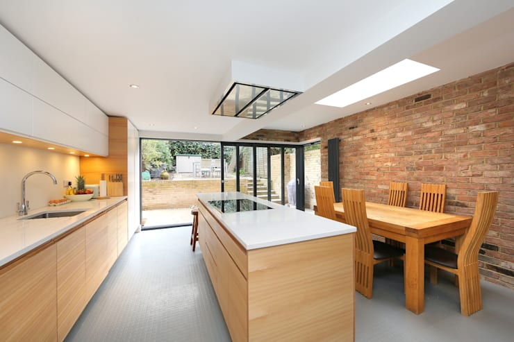 ​kitchen extension dulwich with flat roof and open brickwork:  Kitchen by nuspace