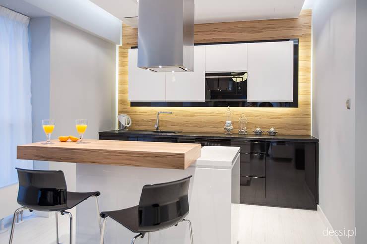 Mieszkanie zaprojektowane pod wynajem: styl , w kategorii Kuchnia zaprojektowany przez Dessi