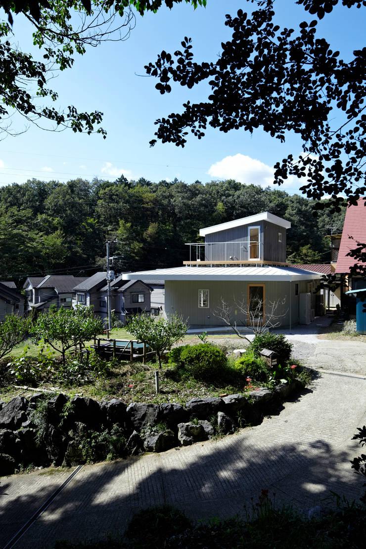 陽傘の家: 池田雪絵大野俊治 一級建築士事務所が手掛けた家です。