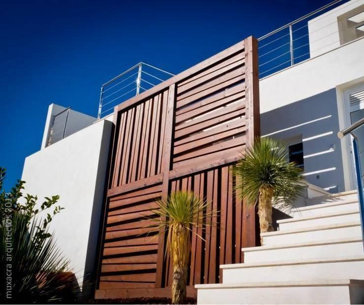 Casa Beirholm: Casas de estilo  de Muxacra Arquitectos