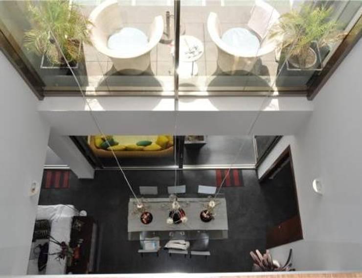 Casa Monne: Comedores de estilo  de Muxacra Arquitectos