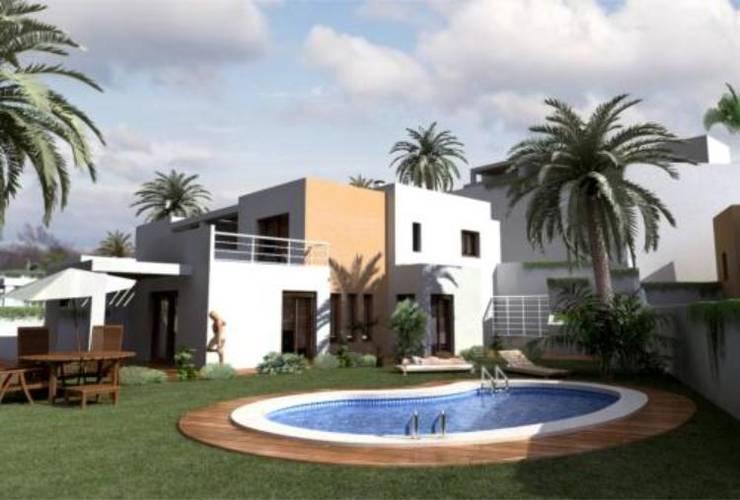 10 viviendas El Pinar: Casas de estilo  de Muxacra Arquitectos