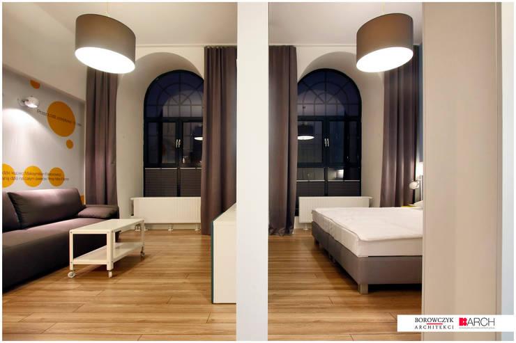 DVUPAK – loft VIVID: styl , w kategorii Salon zaprojektowany przez Borowczyk Architekci