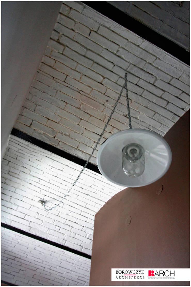 LOFT z wieżą 02: styl , w kategorii  zaprojektowany przez Borowczyk Architekci,Industrialny