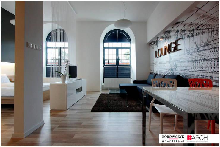 mały LOFT dla singla: styl , w kategorii Salon zaprojektowany przez Borowczyk Architekci,