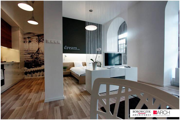 mały LOFT dla singla: styl , w kategorii Sypialnia zaprojektowany przez Borowczyk Architekci,