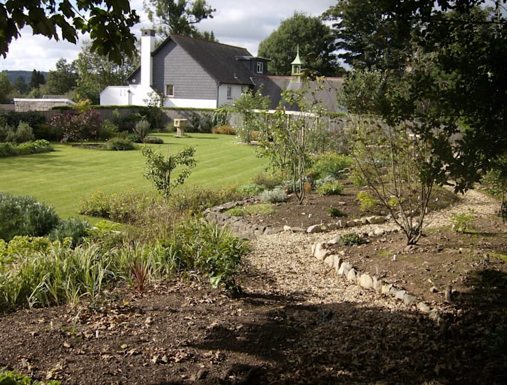 The beginning of the shrub walk:   by Christine Wilson Gardens