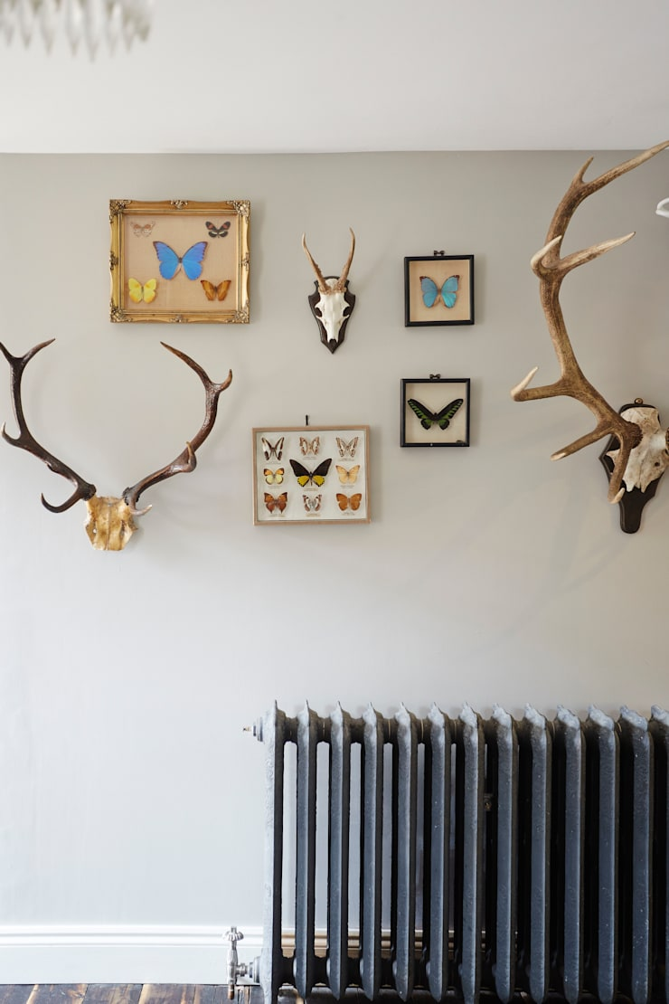Stags in the living room:  Living room by Hart Design and Construction