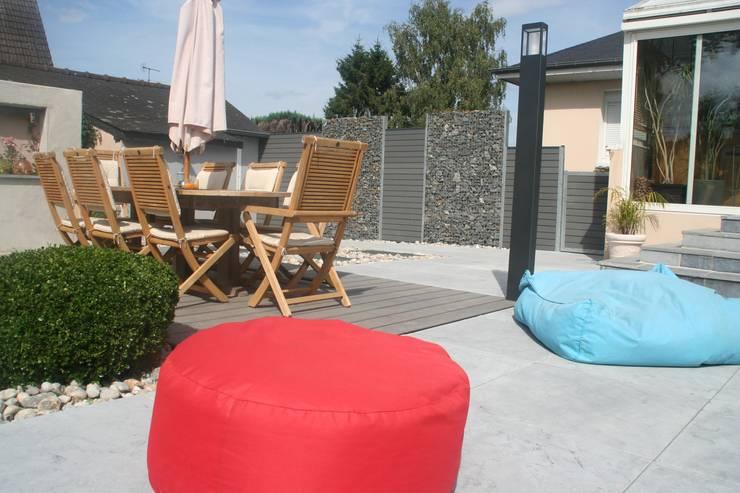 Zone repas: Jardin de style  par EURL OLIVIER DUBOIS