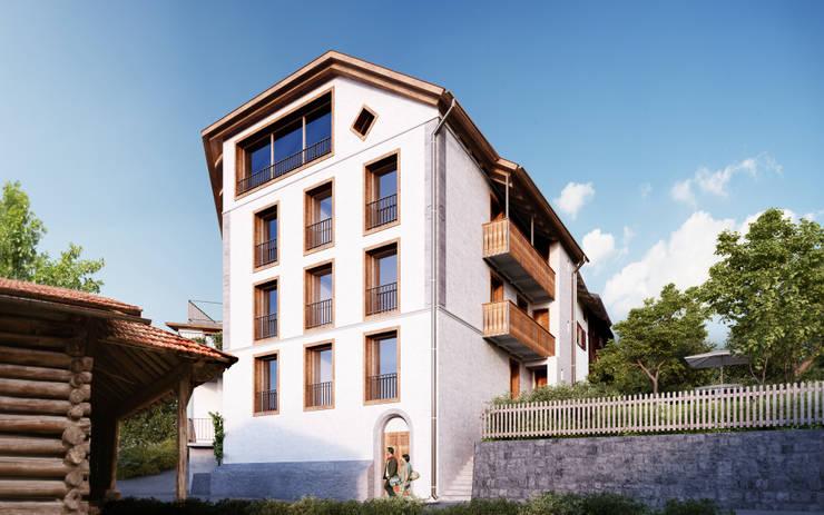 Süd-Ost Fassade: rustikale Häuser von von Mann Architektur GmbH