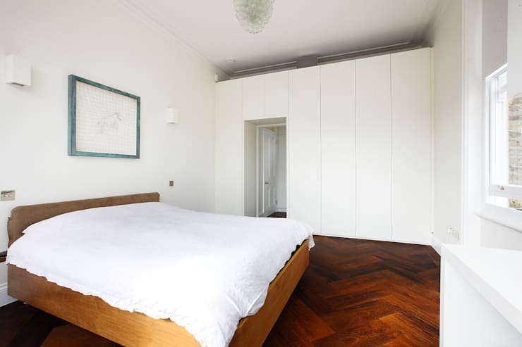 South Brompton Apartments, London: minimalistic Bedroom by PAD ARCHITECTS