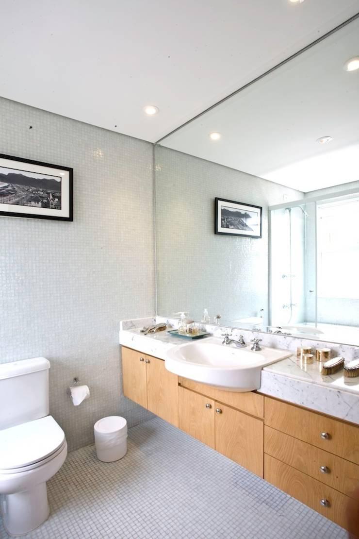 Banheiro: Banheiros  por Pereira Reade Interiores