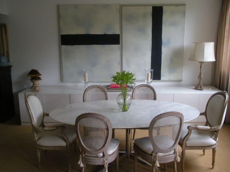 Dining room by Pereira Reade Interiores