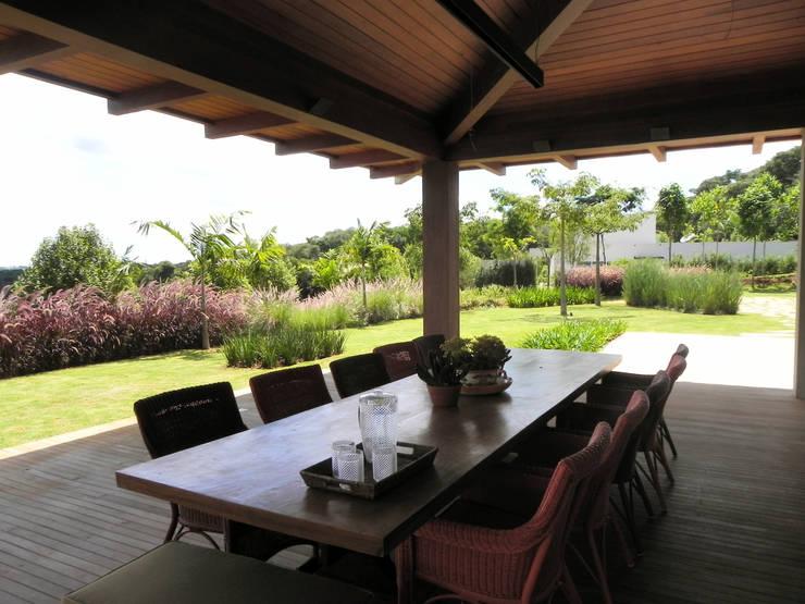 Casa de campo: Jardins  por Catê Poli Paisagismo,Campestre