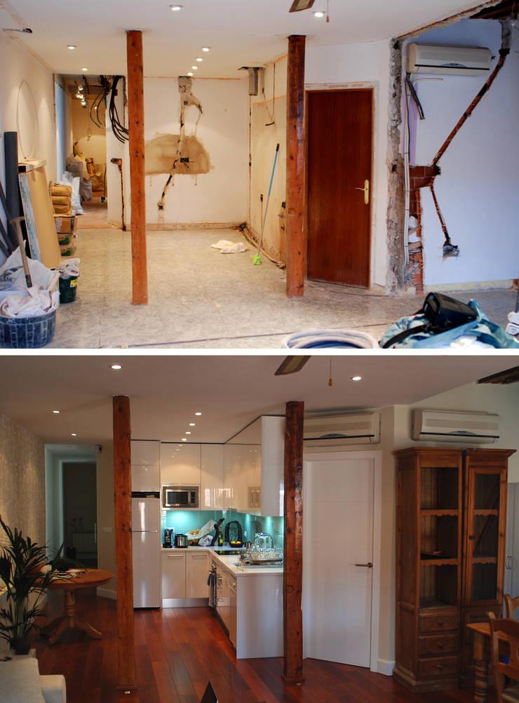 Reforma integral de vivienda en barrio de Chueca de Madrid por Traber Obras. Comedor antes y después.:  de estilo  de Traber Obras