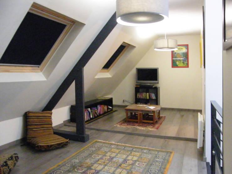 Photo de la maison après travaux : Mezzanine:  de style  par JA'AD