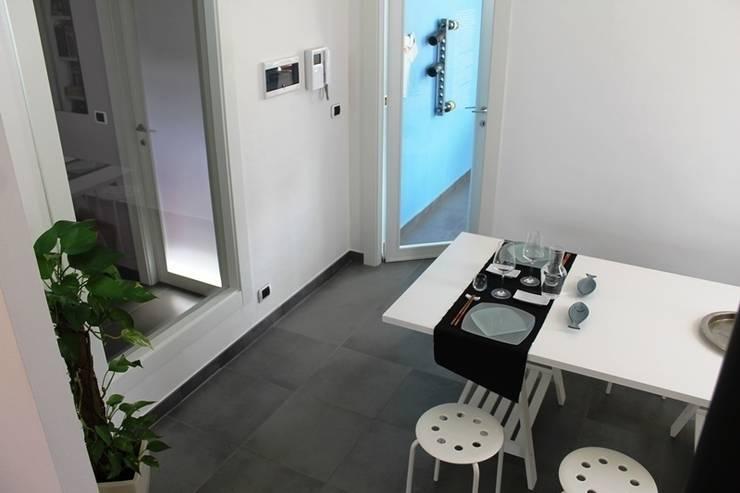 BUON APPETITO!: Sala da pranzo in stile in stile Minimalista di VALENTINA BONANDIN STUDIO TECNICO