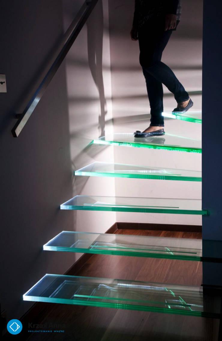 modern home: styl , w kategorii Korytarz, przedpokój zaprojektowany przez Anna Krzak architektura wnętrz