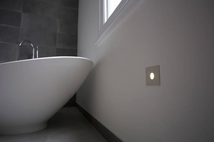 Modern bathroom lighting: modern Bathroom by Affleck Property Services