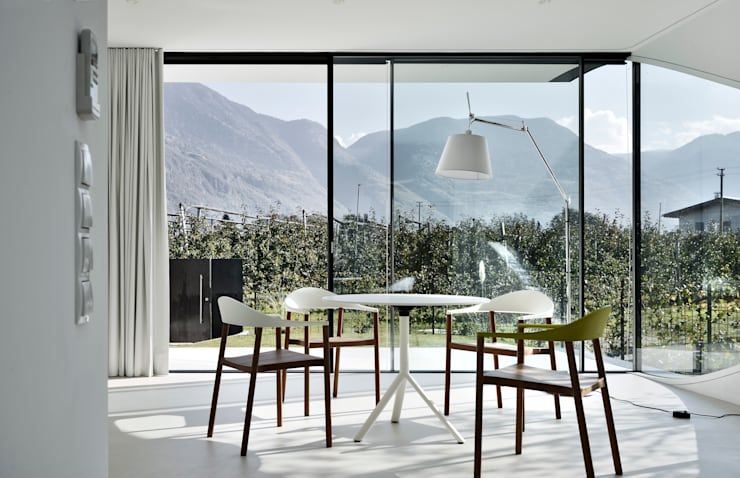 Dining room by Peter Pichler Architecture