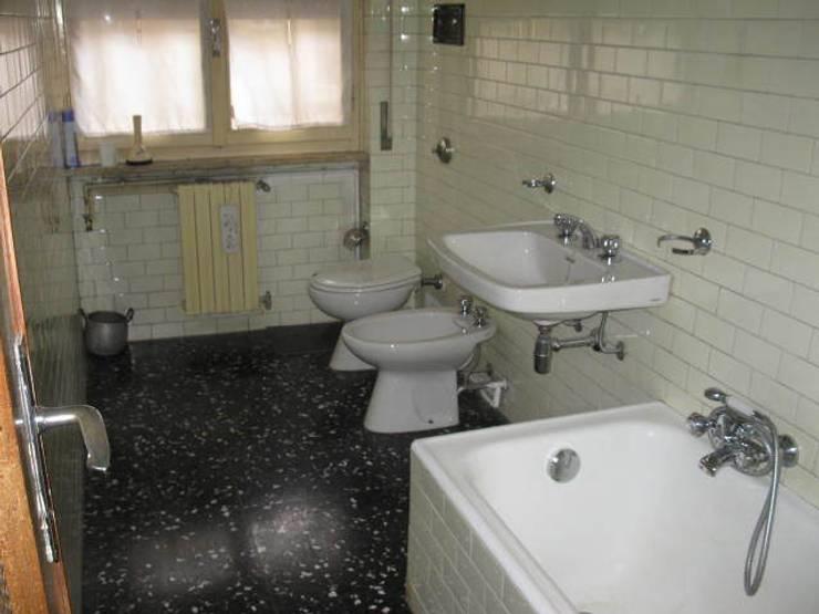Ristrutturazione appartamento a Bergamo: Bagno in stile  di ARKHISTUDIO