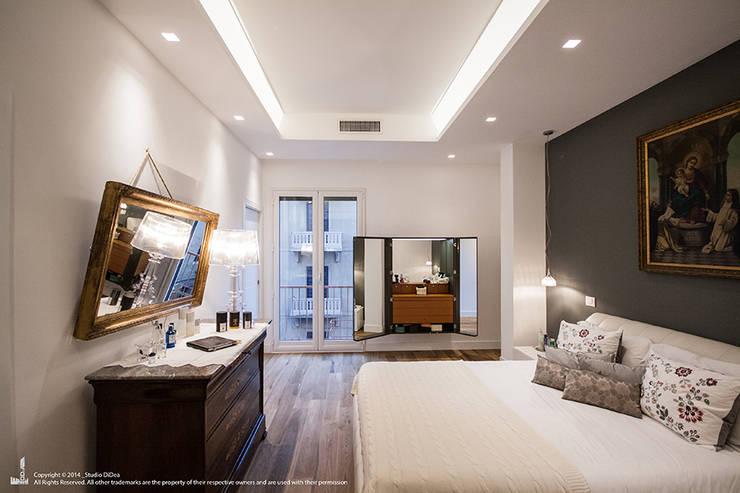 Appartamento #A76: Camera da letto in stile  di Studio DiDeA architetti associati