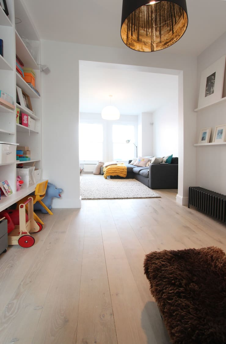 MN Residence:  Living room by deDraft Ltd