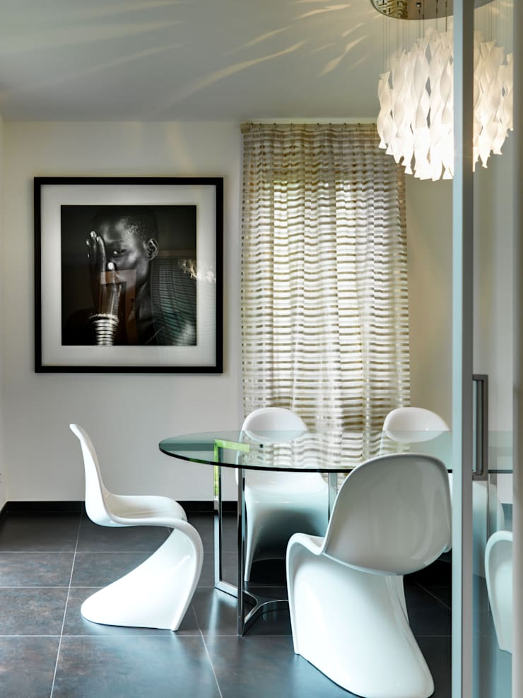 Modern dining room by Studio Marco Piva Modern
