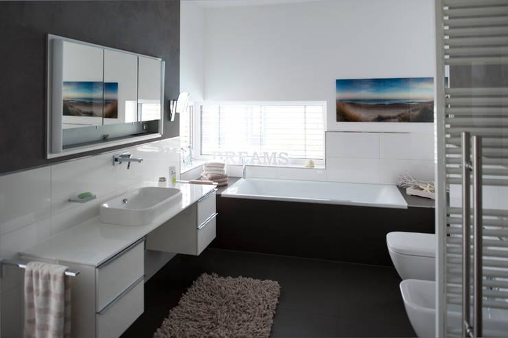 Baños de estilo  por Architekturbüro J. + J. Viethen
