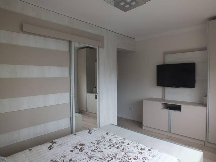 Dormitório do casal: Quartos  por Arketing Identidade e Ambiente