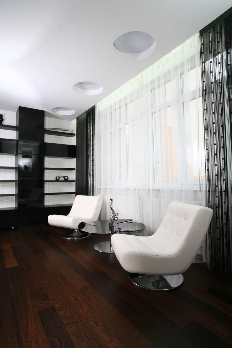 Дизайн интерьера четырехкомнатной квартиры.  г. Саратов: Гостиная в . Автор – Студия Павла Исаева