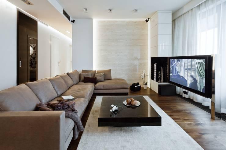 Salon z kamienną ścianą: styl , w kategorii Salon zaprojektowany przez living box