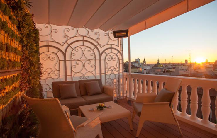 Terraza habitaciones: Hoteles de estilo  de DyD Interiorismo - Chelo Alcañíz