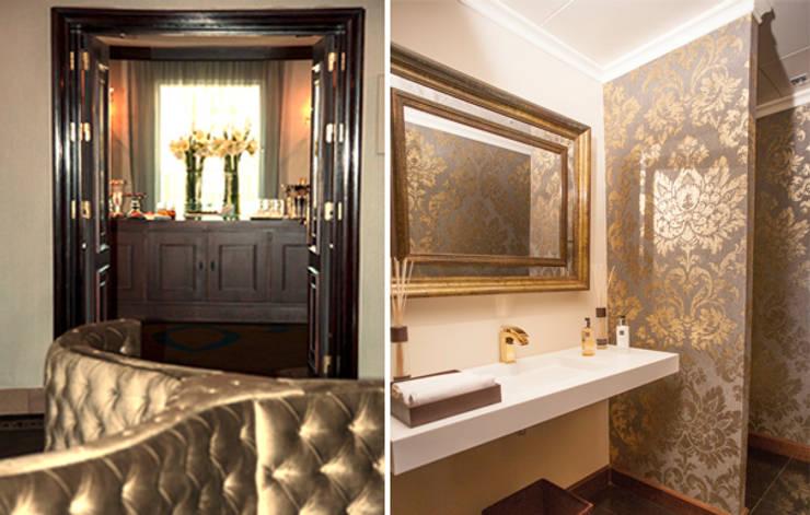 Salón VIP y baño habitaciones: Hoteles de estilo  de DyD Interiorismo - Chelo Alcañíz