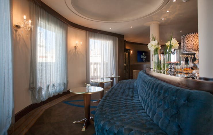 Salón VIP: Hoteles de estilo  de DyD Interiorismo - Chelo Alcañíz