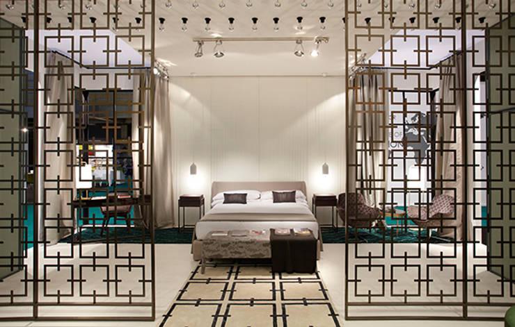 Habitación tipo para stand: Hoteles de estilo  de DyD Interiorismo - Chelo Alcañíz