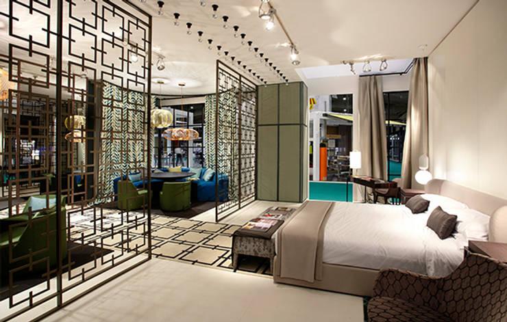 Stand para editor téxtil: Hoteles de estilo  de DyD Interiorismo - Chelo Alcañíz