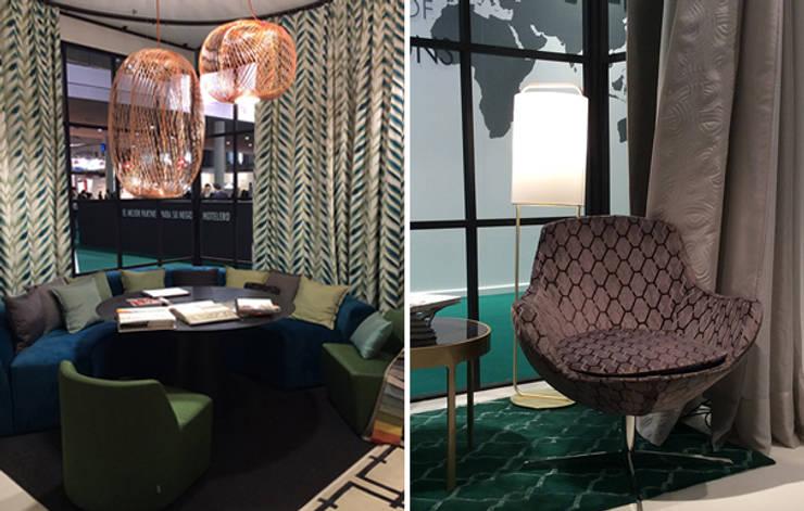 Zona de estar y de reunión stand : Hoteles de estilo  de DyD Interiorismo - Chelo Alcañíz