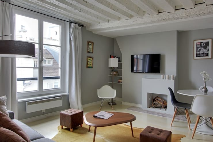 Restructuration d'un appartement à Paris 3ème: Salon de style  par GALI Sulukjian Architecte