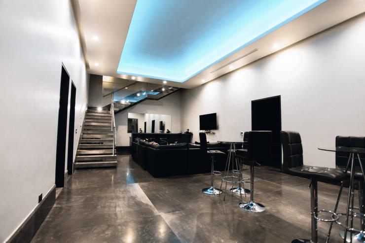 Living room by Diez y Nueve Grados Arquitectos