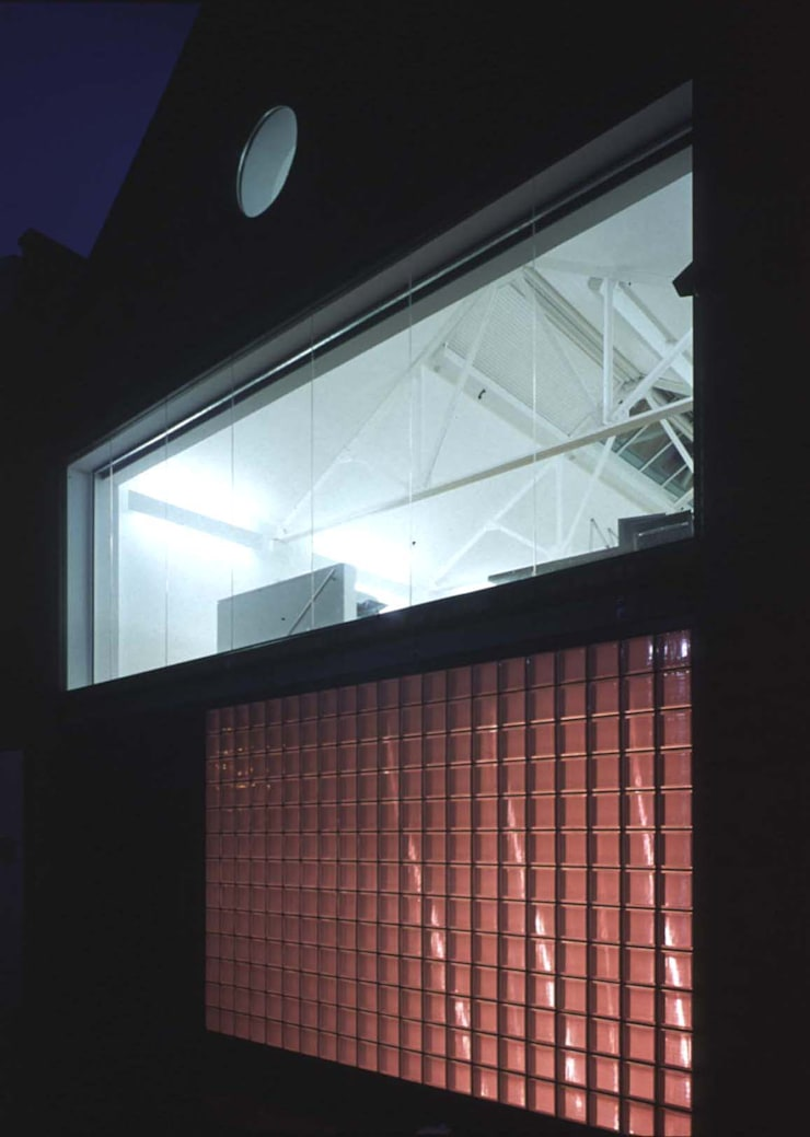Loman Street - exterior close-up night:  Offices & stores by Syte Architects