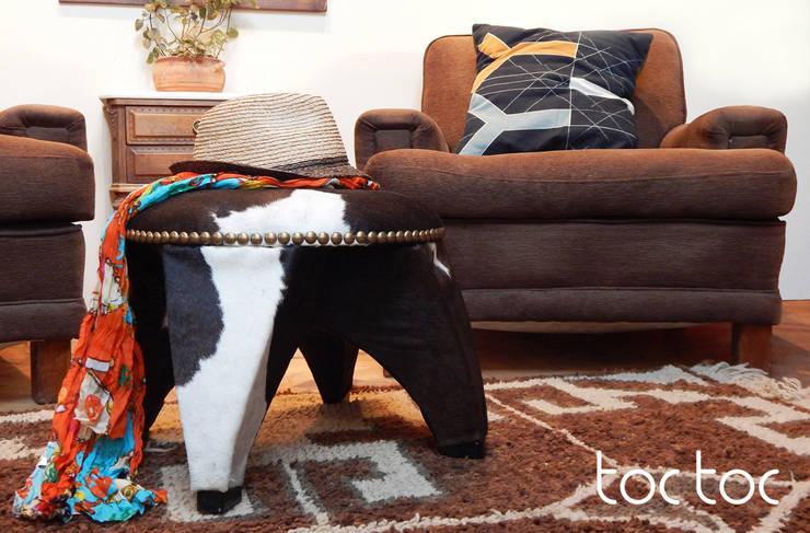 Banco Shu Vaca: Livings de estilo  por TocToc - Muebles y Objetos Argentinos