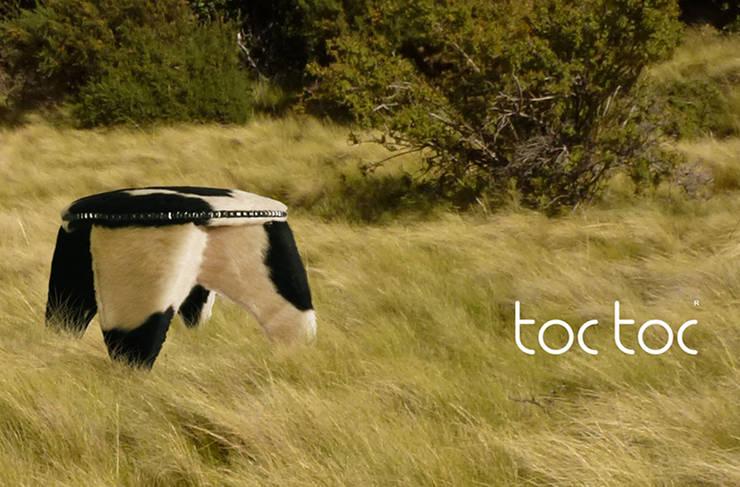 BANCO SHU VACA: Hogar de estilo  por TocToc - Muebles y Objetos Argentinos