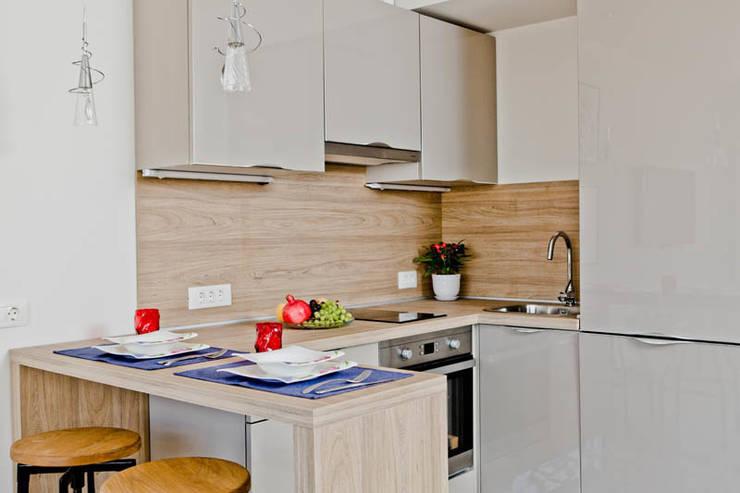 Апартаменты с одной спальней в комплексе <q>Garden of eden</q> Болгария: Кухня в . Автор – Студия Татьяны Гребневой