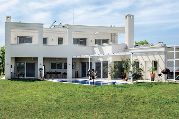 moderne Huizen door La Casa G: La Casa Sustentable en Argentina