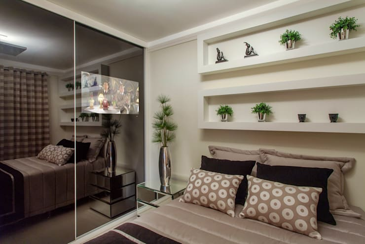 Quartos modernos por Designer de Interiores e Paisagista Iara Kílaris