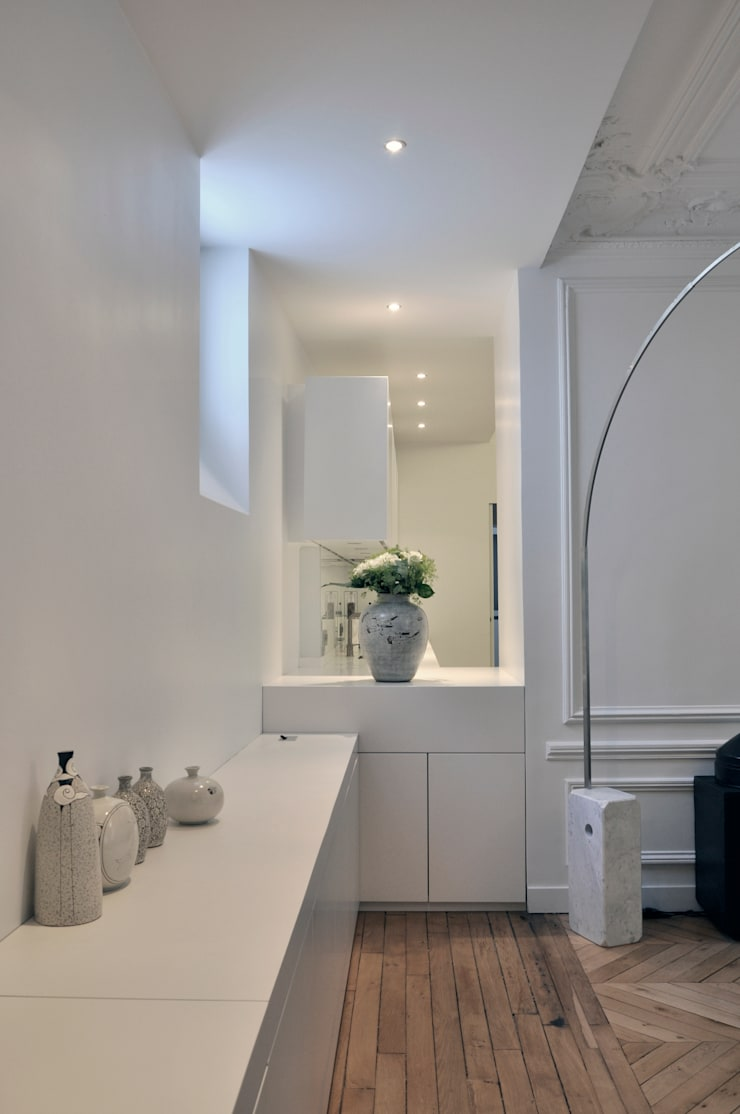 mise en perspective: Salon de style  par officine TNT Architecture