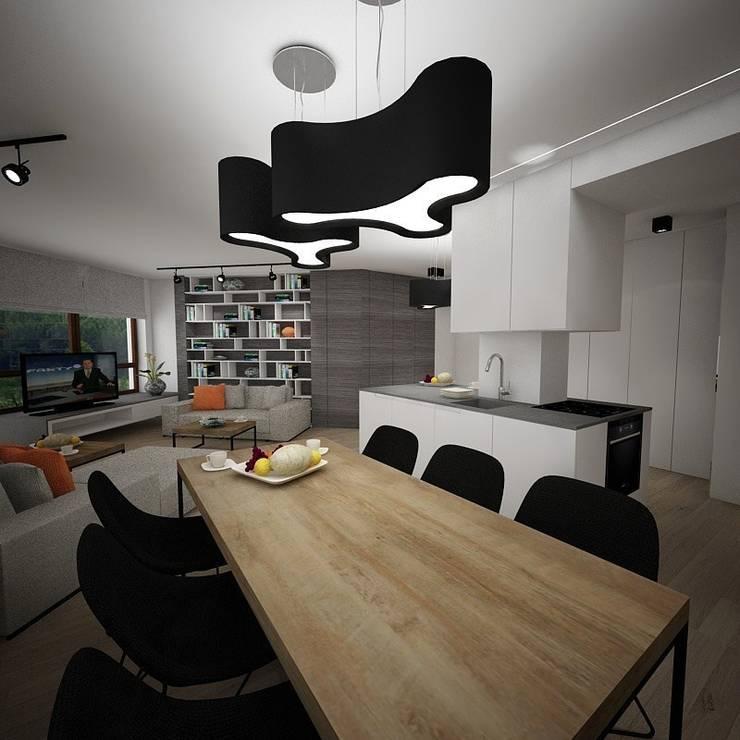 Salon otwartą kuchnią i jadalnią : styl , w kategorii Jadalnia zaprojektowany przez living box