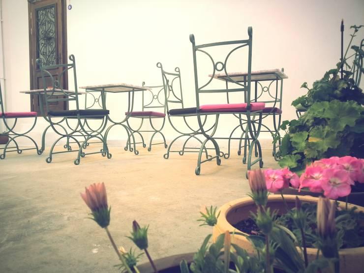Ferhan Tasarım – Bahçe, Egesade Otel:  tarz Oteller