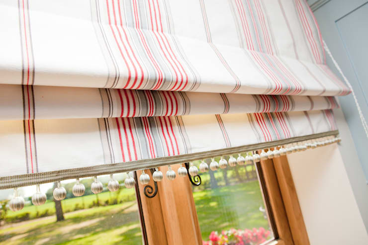 Ivory, taupe and coral red striped Roman blinds with ball fringe:  Kitchen by Design by Deborah Ltd